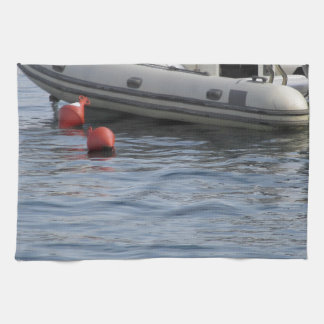 Single inflatable dinghy with outboard motor hand towel