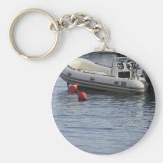 Single inflatable dinghy with outboard motor keychain