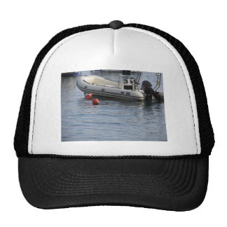 Single inflatable dinghy with outboard motor trucker hat