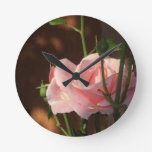 single pink rose in the afternoon round wallclock