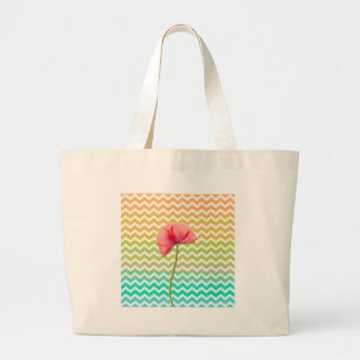 Single red poppy chevron pattern background large tote bag