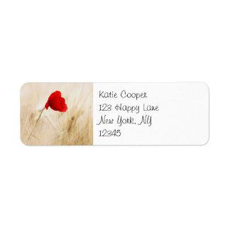 Single Red Poppy in a Grassy Field Label