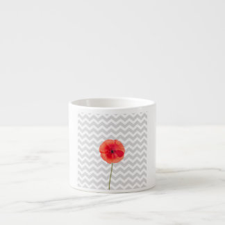 Single red poppy on grey and white chevron pattern espresso cup