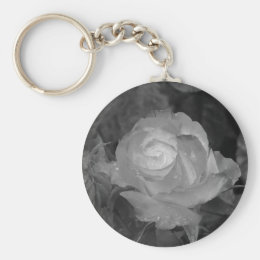 Single rose flower with water droplets in spring keychain