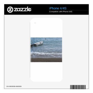 Single rowing boat moored in a harbor on the sea decal for iPhone 4