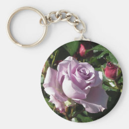 Single violet rose flower with red roses around keychain