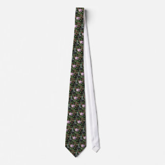 Single violet rose flower with red roses around neck tie