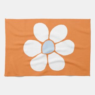 single white flower on orange hand towels