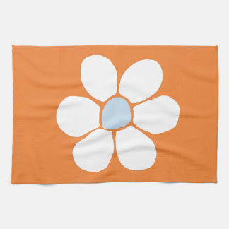 single white flower on orange kitchen towels