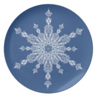 Single white snowflake on blue dinner plate