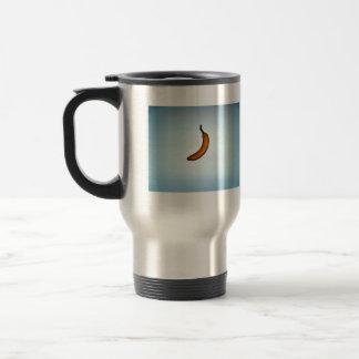 Single whole unpeeled banana travel mug