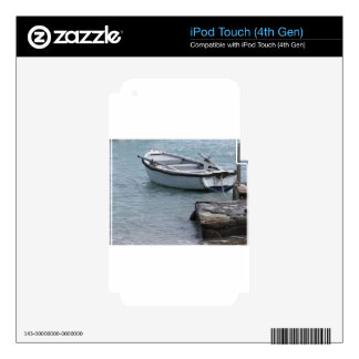 Single wooden rowing boat moored in a harbor iPod touch 4G skins