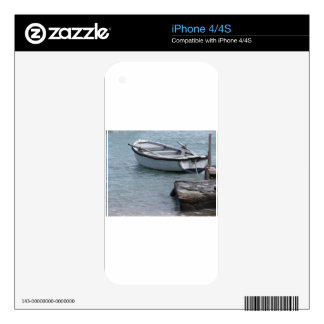 Single wooden rowing boat moored in a harbor skin for iPhone 4