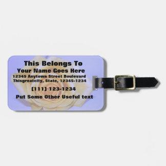 Single yellowish rose blue tinted bag tags