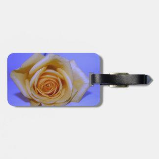 Single yellowish rose blue tinted travel bag tag