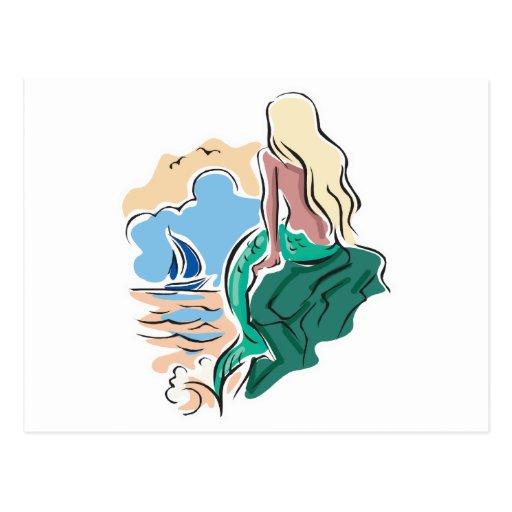 sirena bonita que se sienta en roca postales