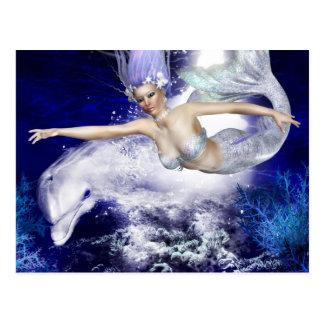 Sirena con la postal del delfín