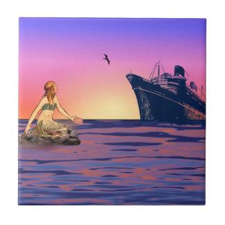 Sirena en la puesta del sol azulejo