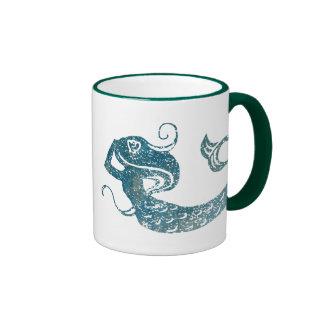 Sirena gastada tazas de café