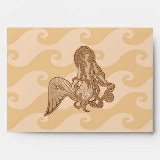 Sirena que se sienta sobre