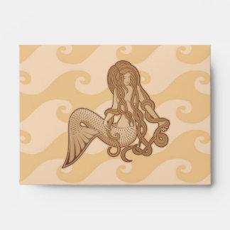 Sirena que se sienta sobres
