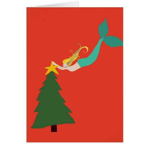 Sirena roja que coloca la estrella en tarjetas de