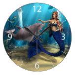 Sirena y delfín reloj