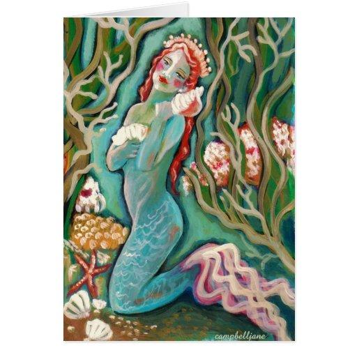 Sirena y la tarjeta de felicitación en blanco de S