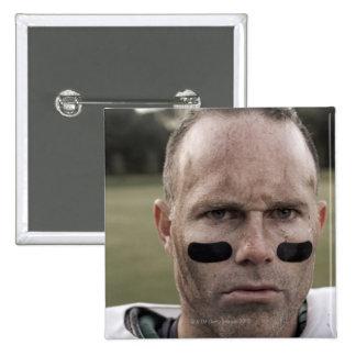 Sirva el equipo del fútbol americano que lleva, pin cuadrado
