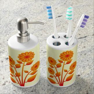Sistema anaranjado del cuarto de baño de la flor vasos para cepillos de dientes