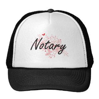 Sistema de trabajo artístico del notario con las gorra