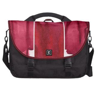 Sistema del extracto rojo de la acuarela pintado a bolsas de portatil