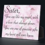 "Sisters greatest love plaque<br><div class=""desc"">Done on a pink feather background &quot;Sister,  you are like my angel,  with a love that always glows. You are one of the greatest gifts my heart will ever know.&quot;</div>"