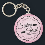 "Sisters in Christ Keychain<br><div class=""desc"">Bold and elegant Christian emblem design with words, &quot;Sisters in Christ&quot; in script with banner design elements. Top center of emblem has words, &quot;Established by grace.&quot; Bottom center of design emblem contains words, &quot;rooted and grounded in Jesus.&quot; Emblem is black on beautiful feminine pink textured background. Area for your custom...</div>"
