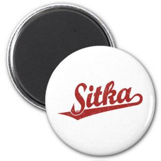 Sitka script logo in red distressed 2 inch round magnet