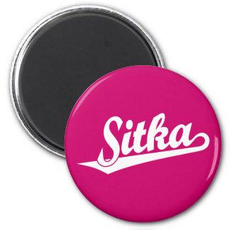 Sitka script logo in white 2 inch round magnet