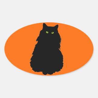Sitting Black Cat Silhouette on Orange Oval Sticker