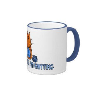sitting knitting mug