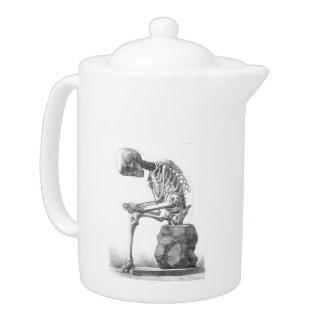 Sitting vintage skeleton thinking teapot