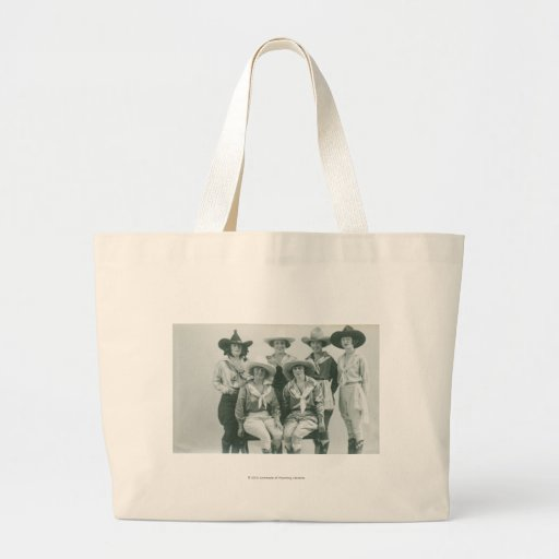 Six cowgirls in hats and sashes. canvas bags
