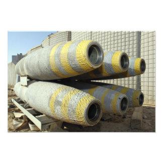 Six GBU-12 bombs sit in a rack Photographic Print