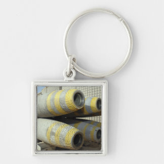 Six GBU-12 bombs sit in a rack Silver-Colored Square Keychain