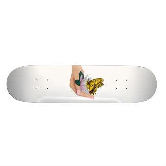 Skateboard butterfly in hand