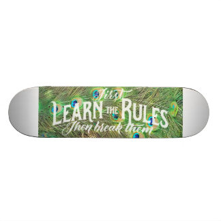 skateboard with photo of peacock feathers & saying