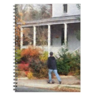 Skateboarder on Sidewalk Spiral Notebook