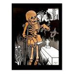 Skeleton Tending the Grave postcard