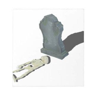 SkeletonLayingFrontHeadstone070315 Notepad