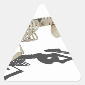 SkeletonProneSideways032215 Triangle Sticker