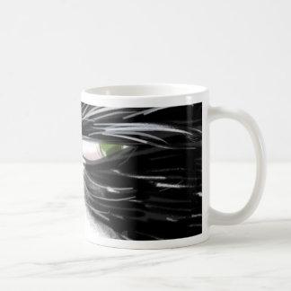 Skeptical cat close-up coffee mug