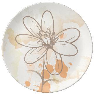 Sketched flower on watercolor paint splats porcelain plate